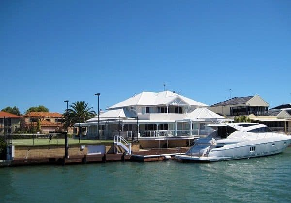 mandurah house with tennis court on water