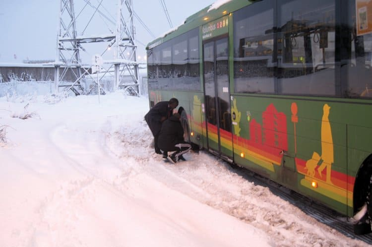digging out bus snowstorm