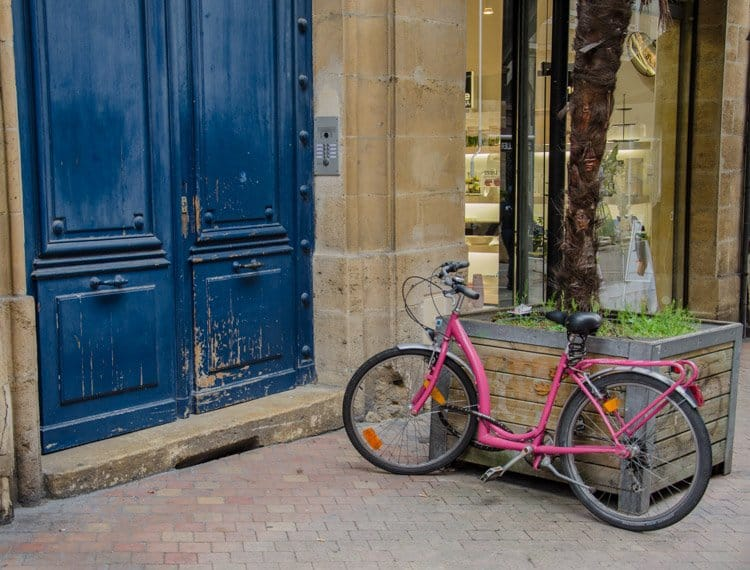blue door and pink bicycle bordeaux